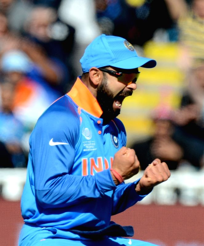 Indian captain Virat Kohli celebrates fall of a wicket during ICC Champions Trophy, Group B match between India and Pakistan at Edgbaston, Birmingham, UK on June 4, 2017. - Virat Kohli