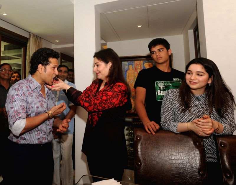 Indian cricket icon Sachin Tendulkar celebrates his 44th birthday with wife Anjali Tendulkar, daughter Sara Tendulkar and son Arjun Tendulkar at his residence in Mumbai on April 24, 2017. - Sachin Tendulkar