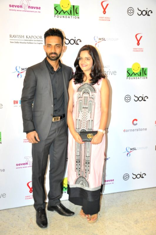 Indian cricket player Ajinkya Rahane with his wife Radhika during the charity dinner hosted by Virat Kohli foundation in association with Smile Foundation, in Mumbai, on June 3, 2016. - Virat Kohli