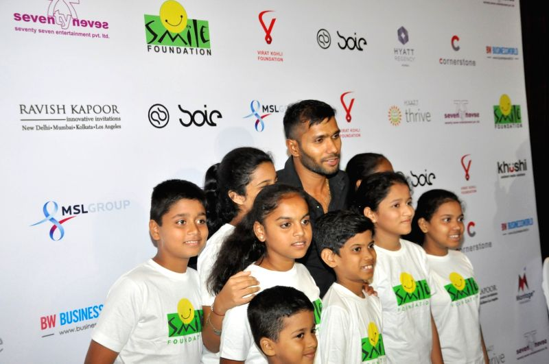 Indian cricket player Ashoke Dinda during the charity dinner hosted by Virat Kohli foundation in association with Smile Foundation, in Mumbai, on June 3, 2016. - Virat Kohli