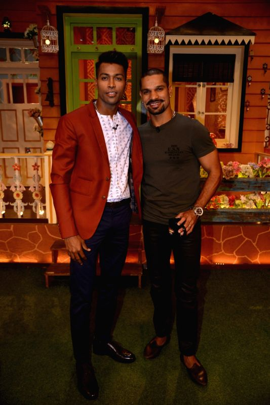 Indian cricket player Hardik Pandya and Shikhar Dhawan on the sets of The Kapil Sharma Show in Mumbai, on May 23, 2017. - Shikhar Dhawan