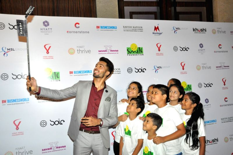 Indian cricket player Hardik Pandya during the charity dinner hosted by Virat Kohli foundation in association with Smile Foundation, in Mumbai, on June 3, 2016. - Virat Kohli