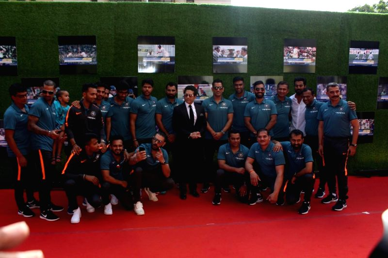 Indian cricket player Sachin Tendulkar along with The Indian cricket team pose for picture during the premiere of film Sachin: A Billion Dreams in Mumbai, on May 24, 2017. - Sachin Tendulkar