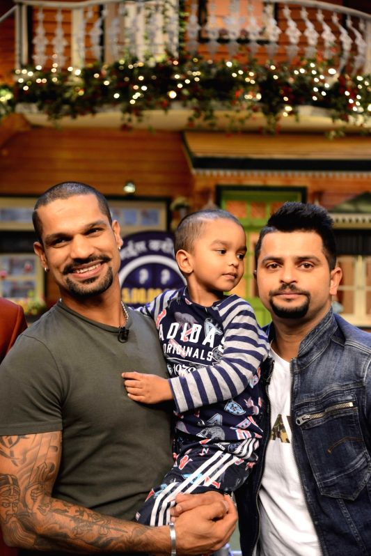 Indian cricket player Suresh Raina, Shikhar Dhawan and son Zoravar Dhawan on the sets of The Kapil Sharma Show in Mumbai, on May 23, 2017. - Shikhar Dhawan