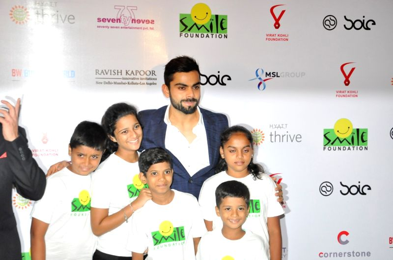 Indian cricket player Virat Kohli with children during the charity dinner hosted by Virat Kohli foundation in association with Smile Foundation, in Mumbai, on June 3, 2016. - Virat Kohli