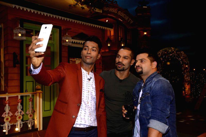 Indian cricket players Suresh Raina, Shikhar Dhawan and Hardik Pandya on the sets of The Kapil Sharma Show in Mumbai, on May 23, 2017. - Shikhar Dhawan