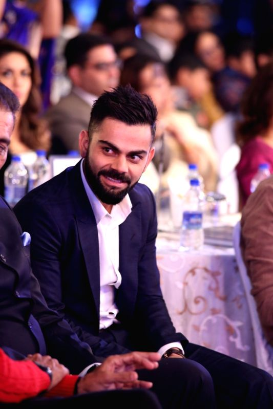 Indian Cricket Team Captain Virat Kohli during Indian of the Year 2017 award ceremony hosted by CNN News 18 in New Delhi, on Nov 30, 2017. Popular Choice for Indian of the Year award goes ... - Virat Kohli