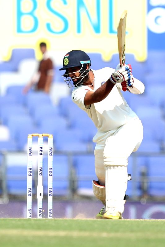Indian cricketer Cheteshwar Pujara in action during the Day-2 of the third test match between India and South Africa at Vidarbha Cricket Association Stadium in Nagpur  on Nov 26, 2015.
