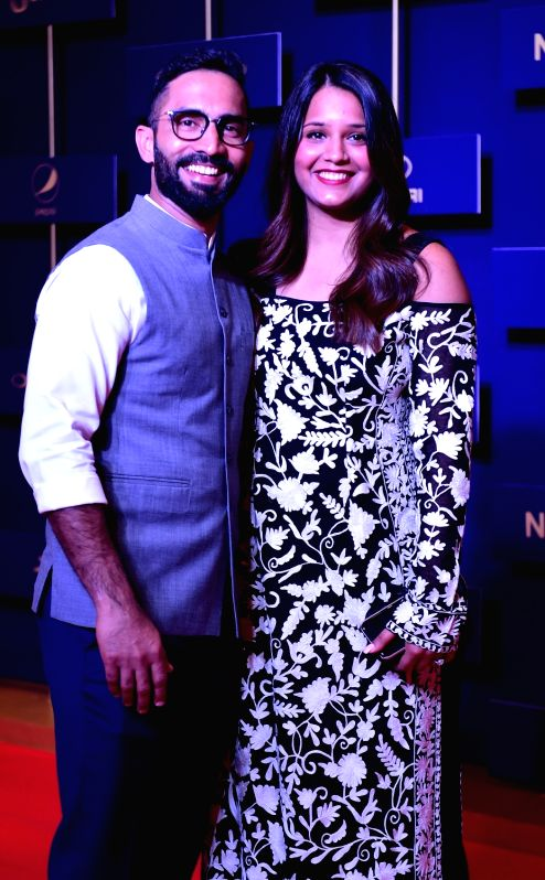 Indian cricketer Dinesh Karthik with his wife and Indian squash player Dipika Pallikal during BCCI annual awards in Bengaluru on June 12, 2018.