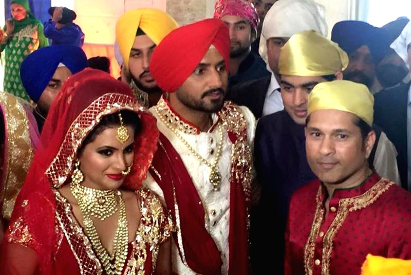 Indian cricketer Harbhajan Singh and his wife Geeta Basra during their marriage ceremony in Jalandhar, on Oct 29, 2015.
