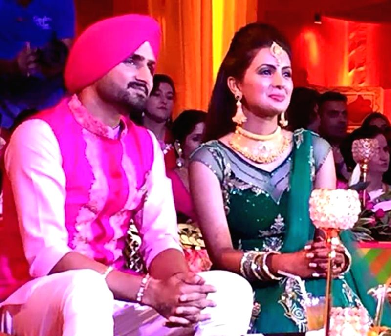 Indian cricketer Harbhajan Singh with Geeta Basra during ladies sangeet ceremony ahead of their marriage in Jalandhar on Oct. 27, 2015.