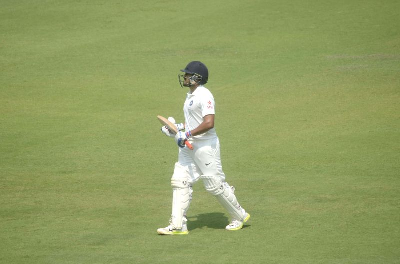 Indian cricketer Karun Nair walks back to the pavilion after his dismissal during a match between Indian Board President`s XI and South African at Brabourne Stadium in Mumbai on Oct 30, 2015.