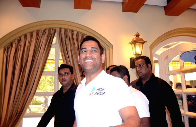 Indian cricketer M.S. Dhoni arrives at the launch of a 360 degree sports tech-ecosystem, in Mumbai, on Aug 7, 2018.