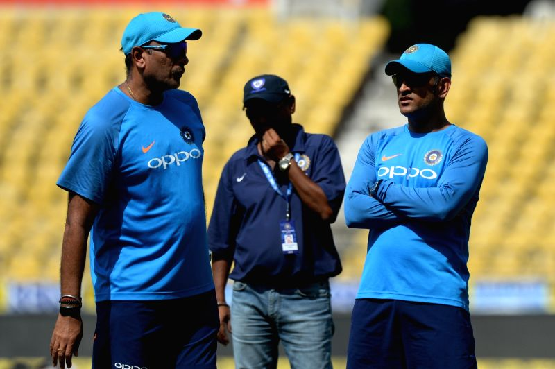 Indian cricketer MS Dhoni and head coach Ravi Shastri during a practice session ahead of the fifth ODI match against Australia in Nagpur, on Sept 30, 2017. - MS Dhoni