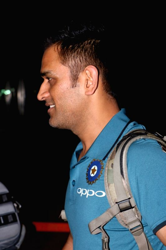 Indian cricketer MS Dhoni ​ ​ ​ departs for England for ICC Champions Trophy 2017​ from Mumbai​ on May 25, 2017. - MS Dhoni