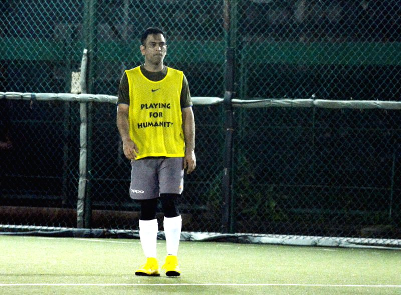 Indian cricketer MS Dhoni during a football match in Bandra, Mumbai on July 22, 2018. - MS Dhoni