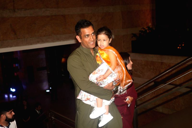 Indian cricketer MS Dhoni with his daughter Ziva Dhoni during sangeet ceremony of All India Football Federation (AIFF) President Praful Patel's daughter Poorna Patel  in Mumbai on July 19, ... - MS Dhoni, Praful Patel and Poorna Patel