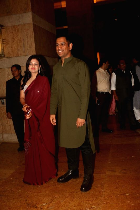 Indian cricketer MS Dhoni with his wife Sakshi Dhoni during sangeet ceremony of All India Football Federation (AIFF) President Praful Patel's daughter Poorna Patel  in Mumbai on July 19, 2018. - MS Dhoni, Praful Patel and Poorna Patel