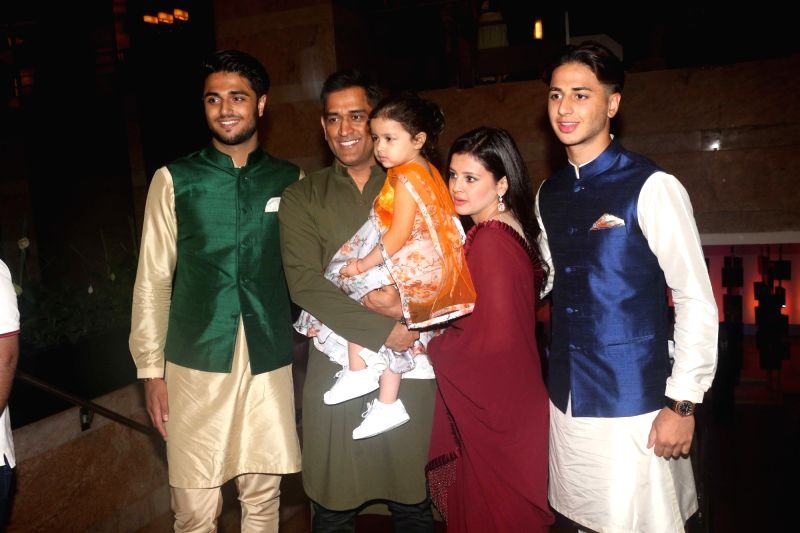 Indian cricketer MS Dhoni with his wife Sakshi Dhoni and daughter Ziva Dhoni during sangeet ceremony of All India Football Federation (AIFF) President Praful Patel's daughter Poorna Patel  in ... - MS Dhoni, Praful Patel and Poorna Patel