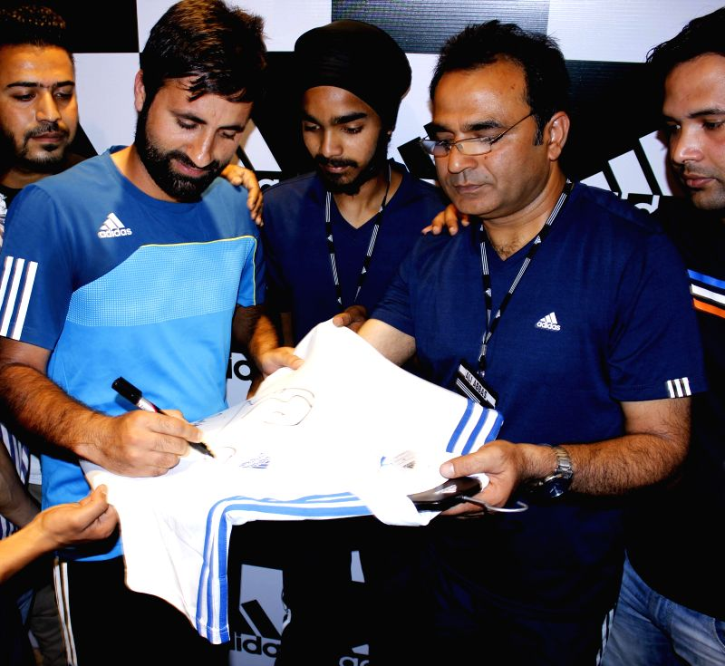 Indian cricketer Parveez Rasool during inauguration of a store of sports goods manufacturing company in Srinagar on June 26, 2014.