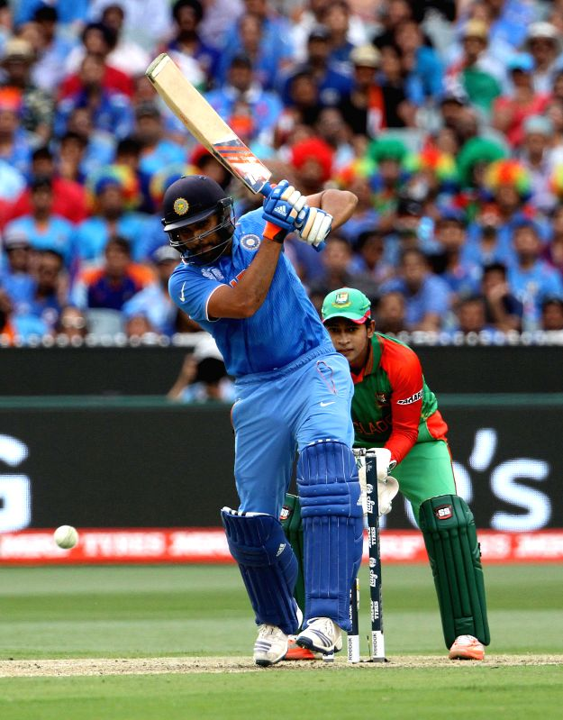 Indian cricketer Rohit Sharma in action during the ICC World Cup - 2015 quarter final match between India and Bangladesh at Melbourne Cricket Ground in Australia on March 19, 2015. - Rohit Sharma