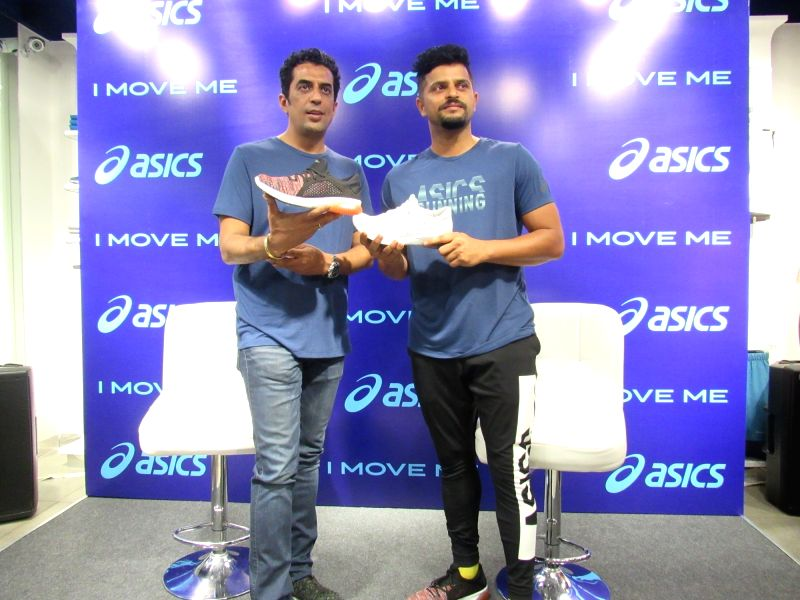 Indian cricketer Suresh Raina and ASICS India MD Rajat Khurana at the launch of a footwear range of ASICS, in Gurugram on May 16, 2018.