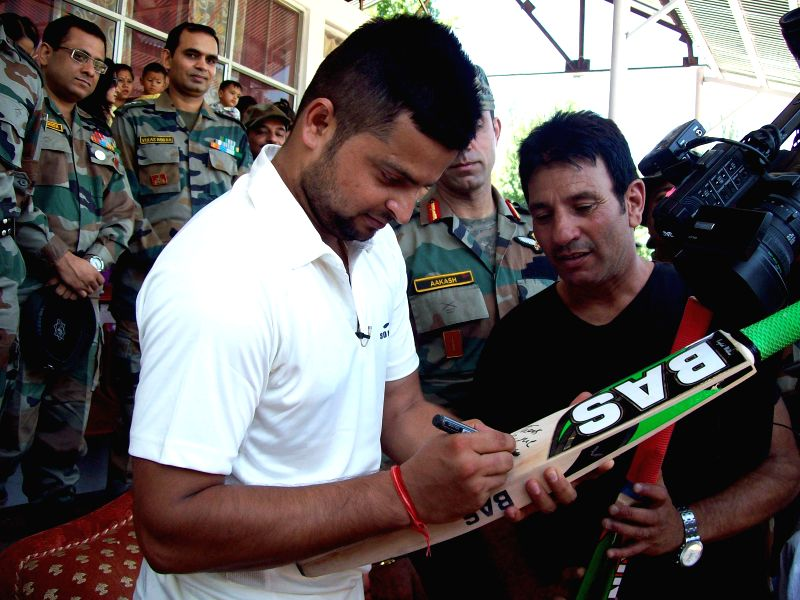 Indian cricketer Suresh Raina during inauguration of Army Cricket Tournament at Sports Stadium in Baramulla of Jammu and Kashmir on Aug 10, 2014.