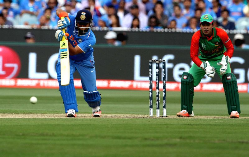 Indian cricketer Suresh Raina in action during the ICC World Cup - 2015 quarter final match between India and Bangladesh at Melbourne Cricket Ground in Australia on March 19, 2015.