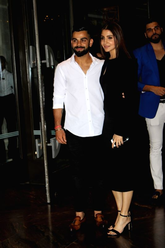 Indian cricketer Virat Kohli and actress Anushka Sharma during the engagement ceremony of Zaheer Khan and Sagarika Ghatge, in Mumbai, on May 23, 2017. - Anushka Sharma, Virat Kohli and Zaheer Khan