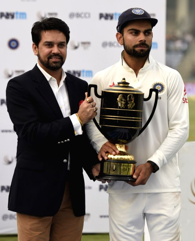 Indian cricketer Virat Kohli and BCCI secretary Anurag Thakur during the presentation ceremony after the Fourth and the final test match between India and South Africa at the Feroz Shah ... - Virat Kohli