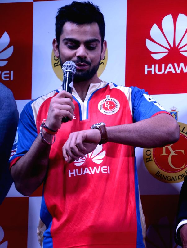 Indian cricketer Virat Kohli during a press conference organised to launch Huawei's new mobile phone in Mumbai on April 13, 2014.