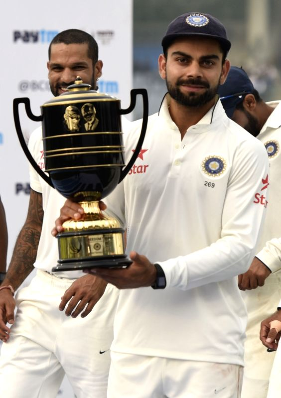 Indian cricketer Virat Kohli during the presentation ceremony after the Fourth and the final test match between India and South Africa at the Feroz Shah Kotla Stadium in New Delhi on Dec. ... - Virat Kohli