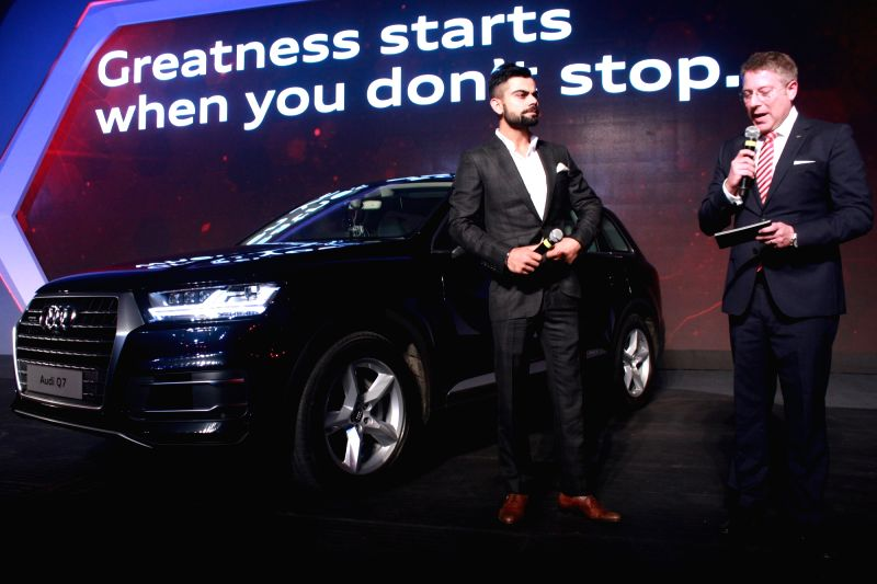 Indian Cricketer Virat Kohli, during the launch of new Audi Q7, in New Delhi on Dec 10, 2015. - Cricketer Virat Kohli