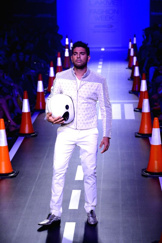 Indian cricketer Yuvraj Singh displays the creation of fashion designer Arjun Khanna during the Lakme Fashion Week (LFW) Winter/ Festive 2014 in Mumbai, on Aug. 23, 2014. - Yuvraj Singh