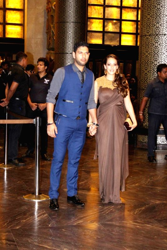 Indian cricketer Yuvraj Singh with fiance actor Hazel Keech during the wedding reception of Preity Zinta and Gene Goodenough in Mumbai, on May 13, 2016. - Hazel Keech, Preity Zinta and Yuvraj Singh