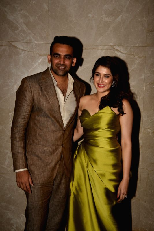 Indian cricketer Zaheer Khan and actress Sagarika Ghatge pose during their engagement ceremony, in Mumbai, on May 23, 2017. - Sagarika Ghatge and Zaheer Khan