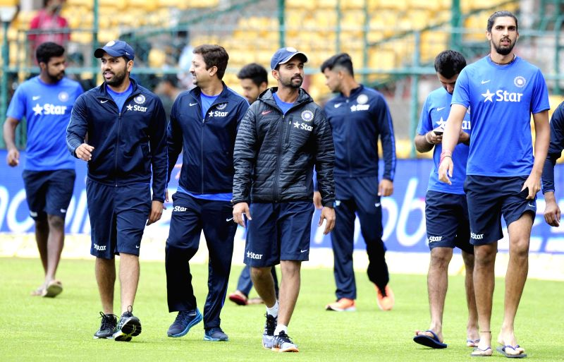 Indian cricketers Ajinkey Rahane, Ishant Sharma and Rohit Sharma at M Chinnaswamy Stadium in Bengaluru, on Nov 18, 2015. The second test match between India and South Africa has been ... - Ishant Sharma and Rohit Sharma