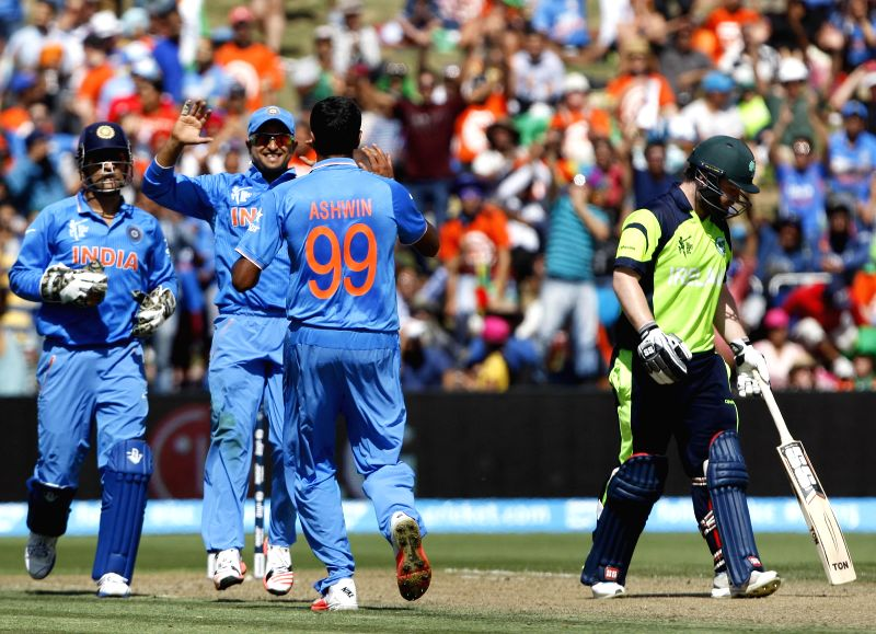 Indian cricketers celebrate fall of a wicket during an ICC World Cup - 2015 match against Ireland at the Seddon Park in Hamilton, New Zealand  on March 10, 2015.