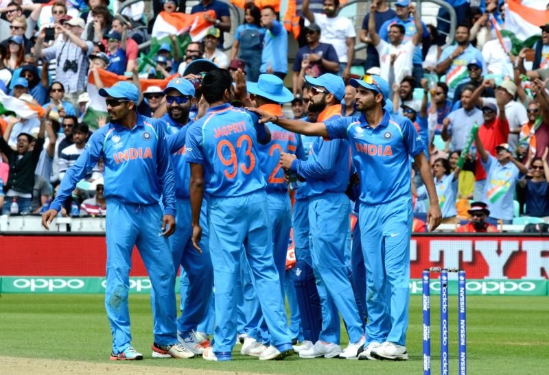 Indian cricketers celebrate fall of a wicket during an ICC Champions Trophy match between India and South Africa at Kennington Oval in London on June 11, 2017.