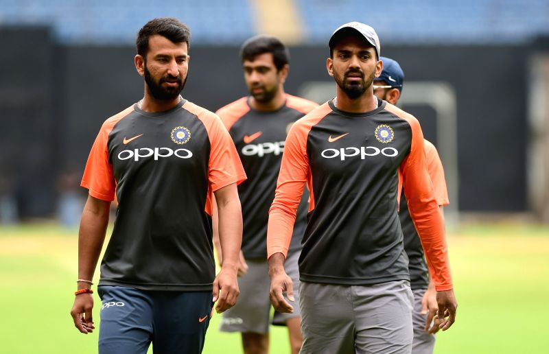 Indian cricketers Cheteshwar Pujara and K.L. Rahul during a practice session ahead of their maiden cricket test match against Afghanistan, in Bengaluru on June 11, 2018. - L. Rahul