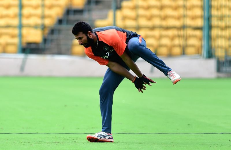 Indian cricketers Cheteshwar Pujara during a practice session ahead of their maiden cricket test match against Afghanistan, in Bengaluru on June 11, 2018.
