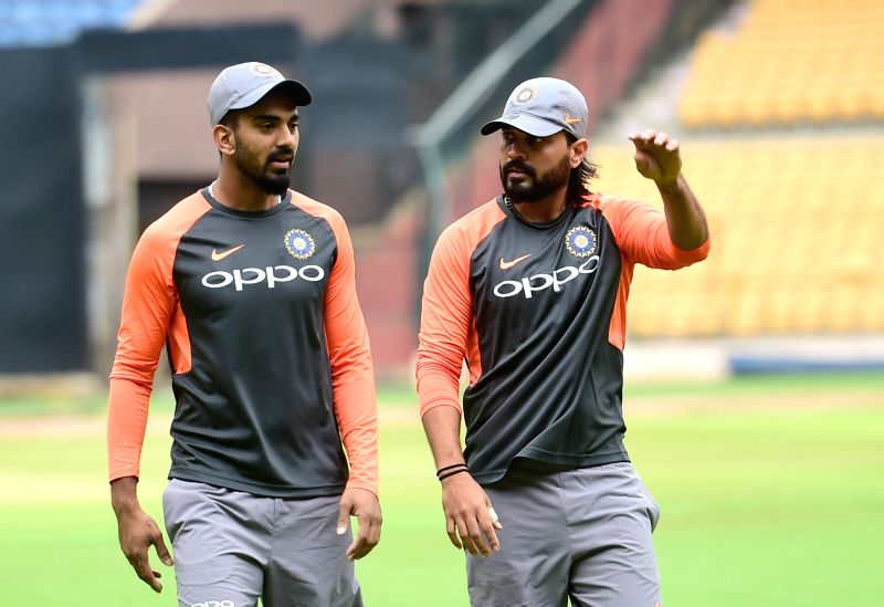 Indian cricketers Murali Vijay and K.L. Rahul during a practice session ahead of their maiden cricket test match against Afghanistan, in Bengaluru on June 11, 2018. - L. Rahul