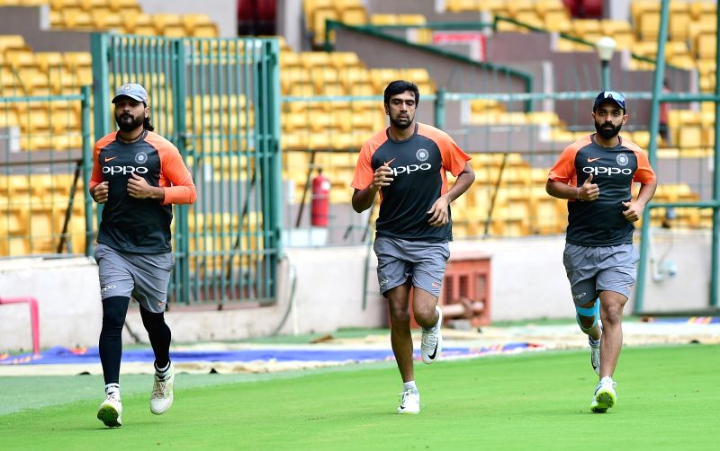 Indian cricketers Murali Vijay, Ravichandran Aswin and Ajinkya Rahane during a practice session ahead of their maiden cricket test match against Afghanistan, in Bengaluru on June 11, 2018.