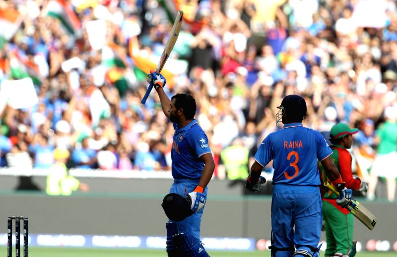 Indian cricketers Rohit Sharma and Suresh Raina during the ICC World Cup - 2015 quarter final match between India and Bangladesh at Melbourne Cricket Ground in Australia on March 19, 2015. - Rohit Sharma