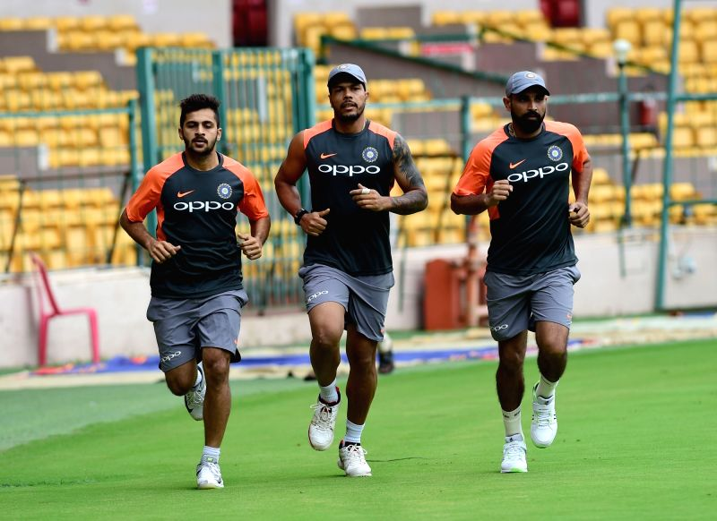 Indian cricketers Shardul Thakur, Umesh Yadav and Mohammad Shami during a practice session ahead of their maiden cricket test match against Afghanistan, in Bengaluru on June 11, 2018. - Umesh Yadav