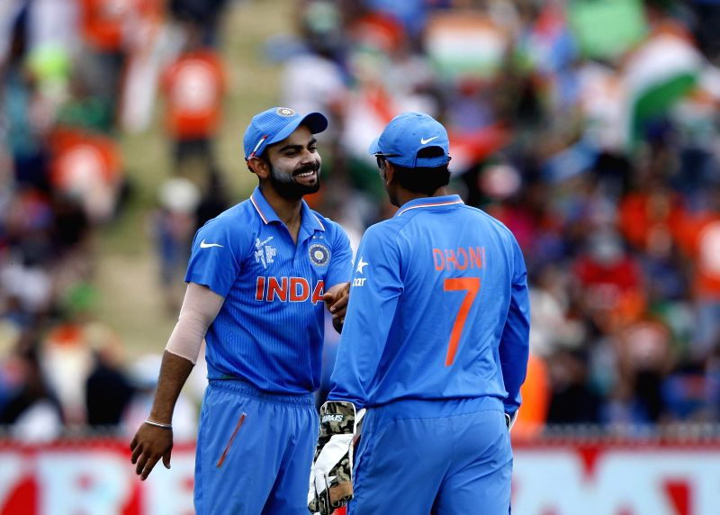 Indian cricketers Virat Kohli and MS Dhoni during an ICC World Cup - 2015 match against Ireland at the Seddon Park in Hamilton, New Zealand  on March 10, 2015. - MS Dhoni and Virat Kohli
