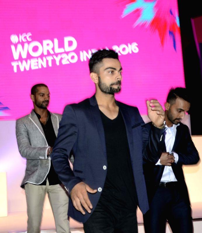 "Indian cricketers Virat Kohli Shikhar Dhawan and Ajinkya Rahane during a programme organised to unveil the trophy of ""ICC World Twenty20"" in Mumbai, on Dec 11, 2015. - Shikhar Dhawan"