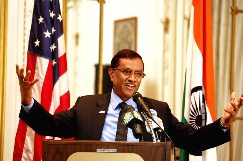 Indian envoy to US Dnyaneshwar Mulay speaks during the Roshni Awards curtain raiser event held at Indian Consulate in New York on Dec 5, 2014.