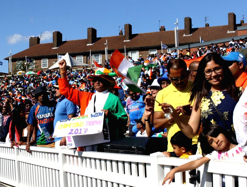 Indian fans cheer during an ICC Champions Trophy match between India and South Africa at Kennington Oval in London on June 11, 2017.