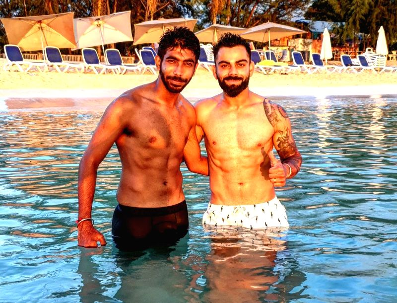 Indian fast bowler Jasprit Bumrah shared a picture on his social media handles of him and captain Virat Kohli enjoying a day out at Jolly beach ahead of the start of first Test against the West Indies in Antigua. All members of the team, including Ko